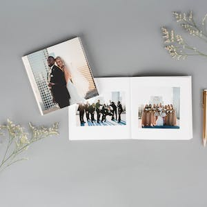 Anniversary photo book with flowers and gold pen
