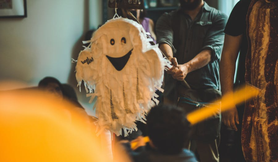 Ghost piñata game with kids