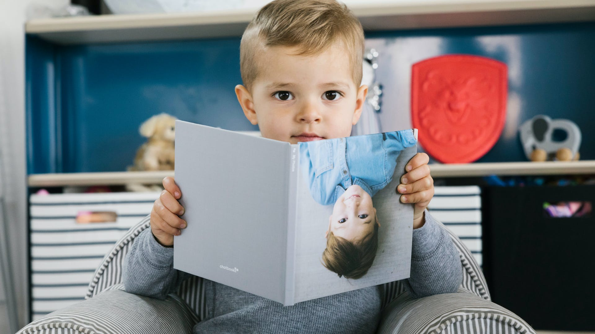 Boy with Chatbooks photo book