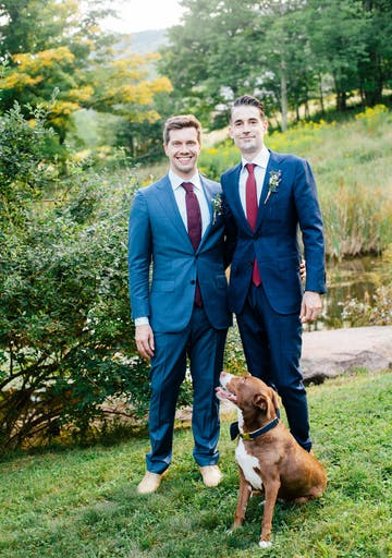 Couple poses on wedding day with pet
