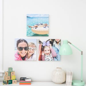 3 family wall tiles hanging above a white dresser in a little girl's bedroom