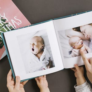 Mother and Baby look through a Christmas Chatbook full of baby photos