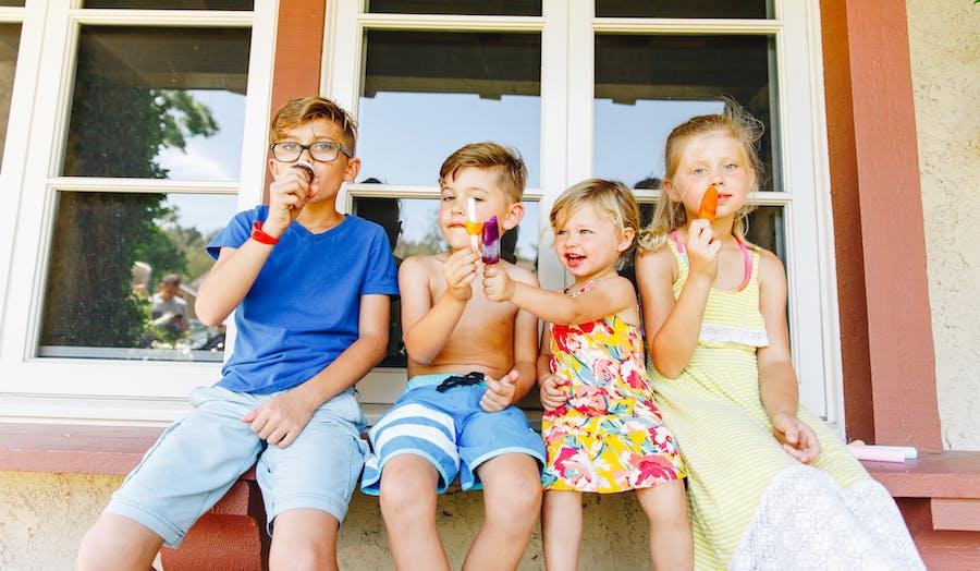 Children eating popsicles together