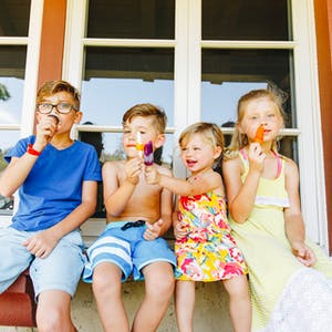 Children eating popsicles together