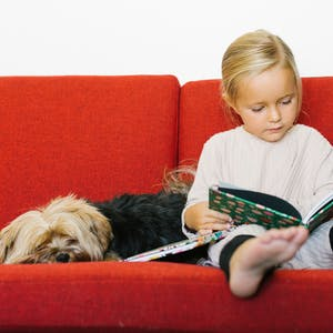 Little girl and dog with Chatbooks