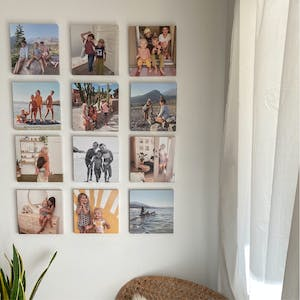 gallery wall of photo tiles in living room