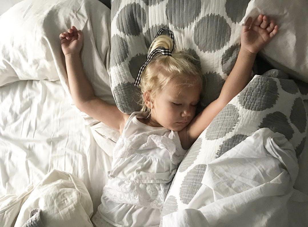 baby sleeping in parents bed