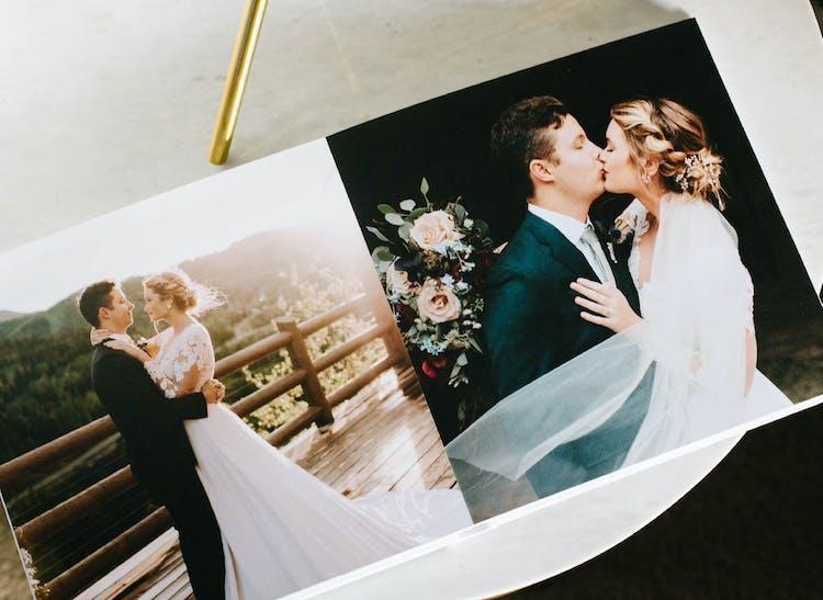 layflat photo album showing couple kissing on wedding day