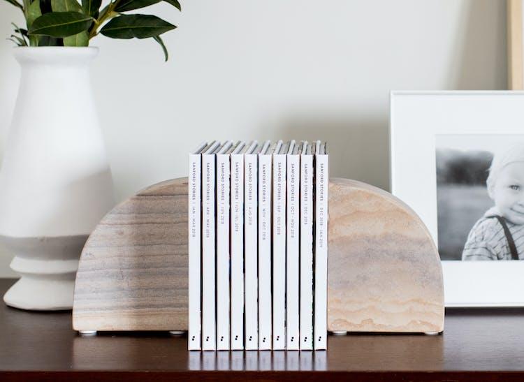 Instagram photo books on bookshelf between 2 bookends