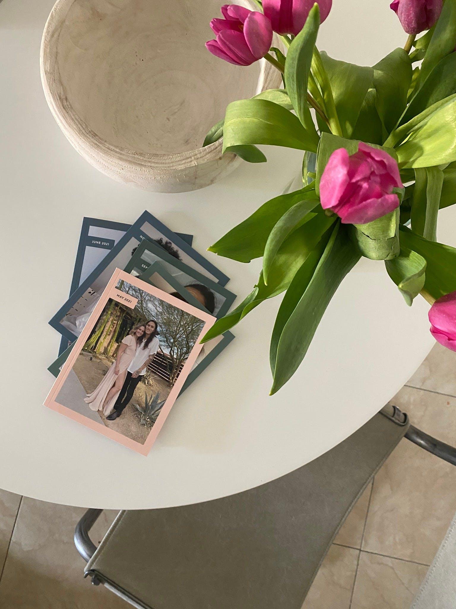 Photo books on kitchen table