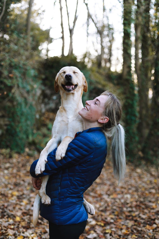 Owner holding her dog