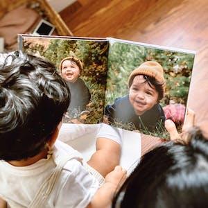 baby looking at photo book