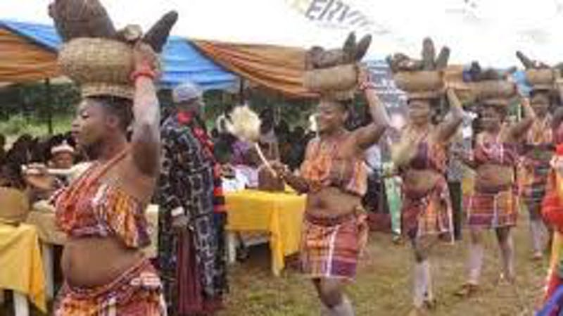 The young maiden during the new yam festival performing different dancing steps with yam on their heads