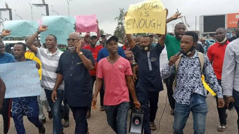 Members of the Coalition for Civil Societies in Osun State, who on Friday morning protested against the hike in electricity tariff and petrol price.