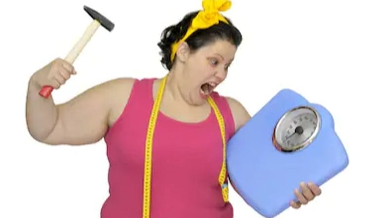An angry woman unsatisfied with her weight