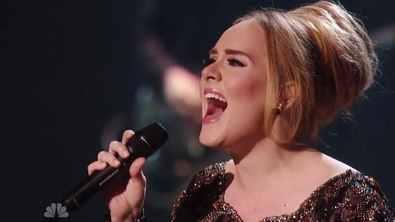 Famous English singer Adele on stage singing