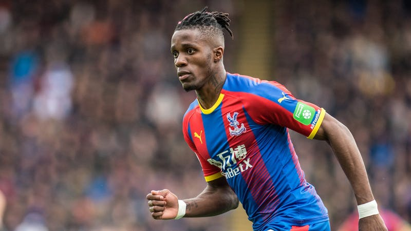 Crystal Palace Wilfred Zaha in action for his club wearing the home kit