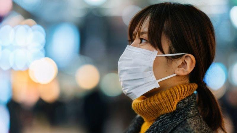 A lady wearing nose mask