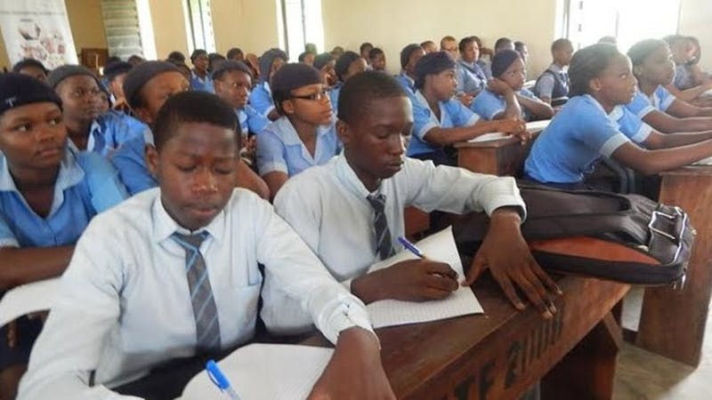 Senior Secondary students writing test in a class room