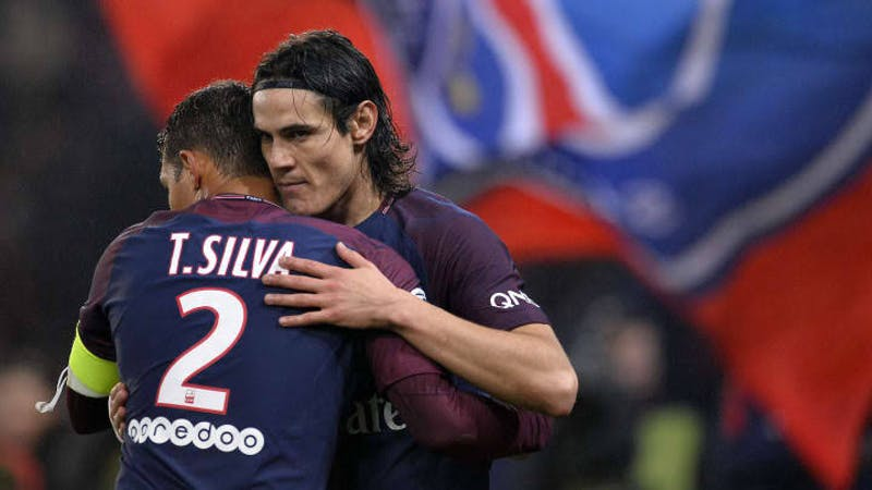 PSG pair Edison Cavani and Thiago Silva in a pitch celebrating after the final whistle