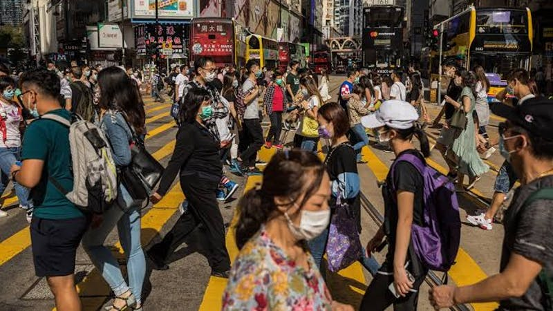 People wearing face masks going about their normal activities in the Causeway bay shopping district Hong Kong