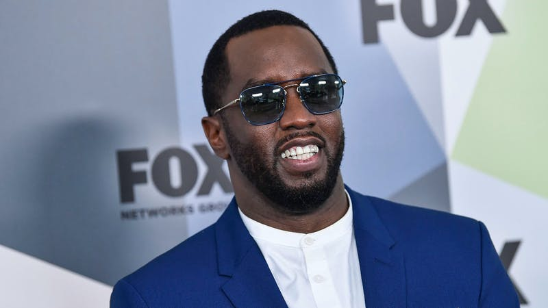 Famous American rapper Diddy in a blue suit