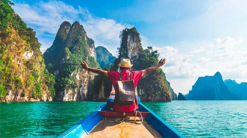 A man in boat cruise on a vacation - Top 10 ways to travel the world