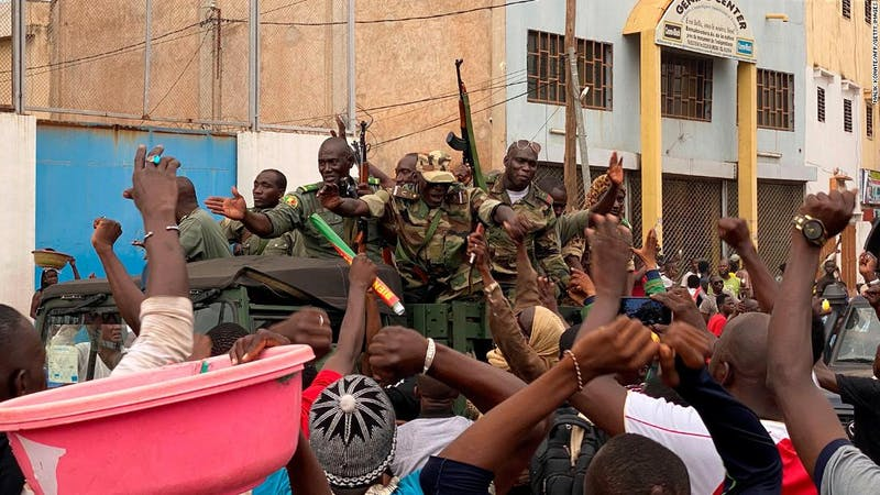 Malian soldiers celebrated as they arrive indepence square in Bamako following the resignation of the president, Keita