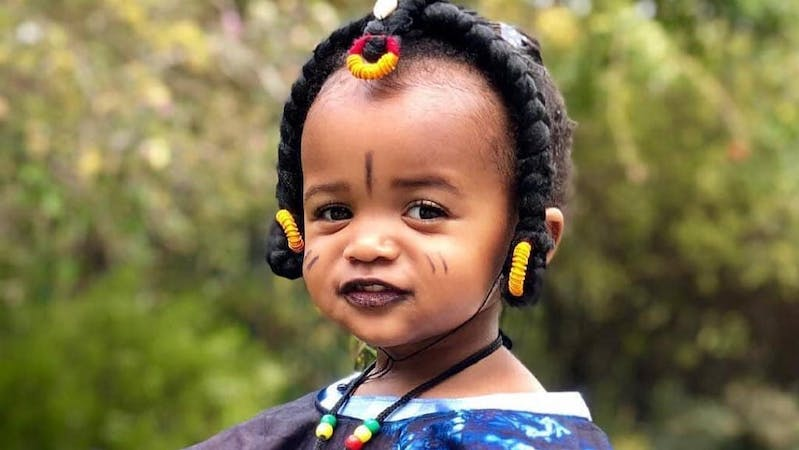 A baby in a Fulani attire made with Capalla