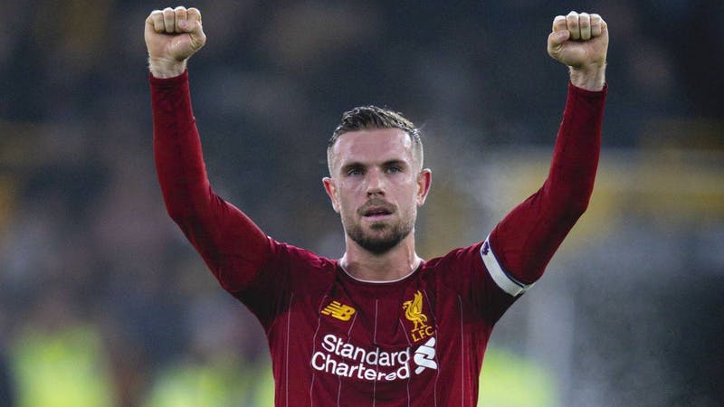 Liverpool captain Jordan Henderson greeting the fans after a victory