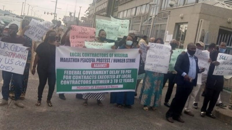 Group, known as local contractors of Nigeria protest against non-payment of contracts by the Finance Ministry in Abuja.