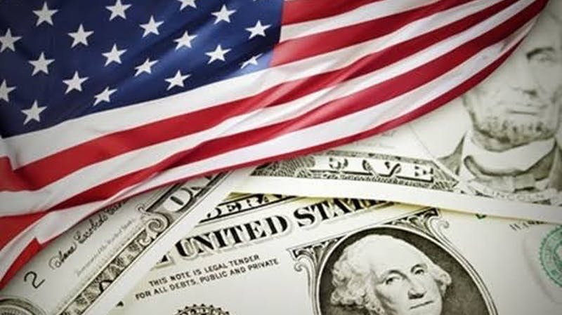 American flag and the US dollar: United States economy plunged into economic recession as a result of the COVID-19 pandemic