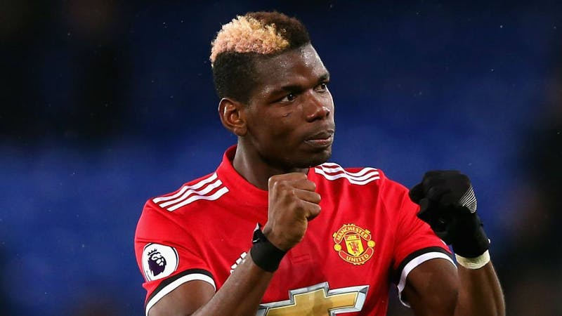 Paul Pogba in Manchester United home kit celebrating a goal