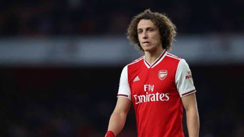 Arsenal defender David Luiz on Arsenal jersey frowning over a lost match