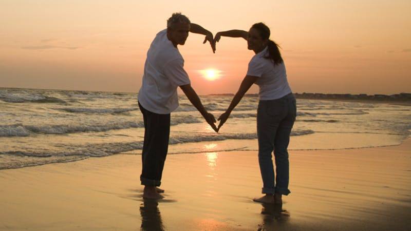 Picture showing two lovers with artful love symbol. Love, the climax of togetherness, emotions and joy