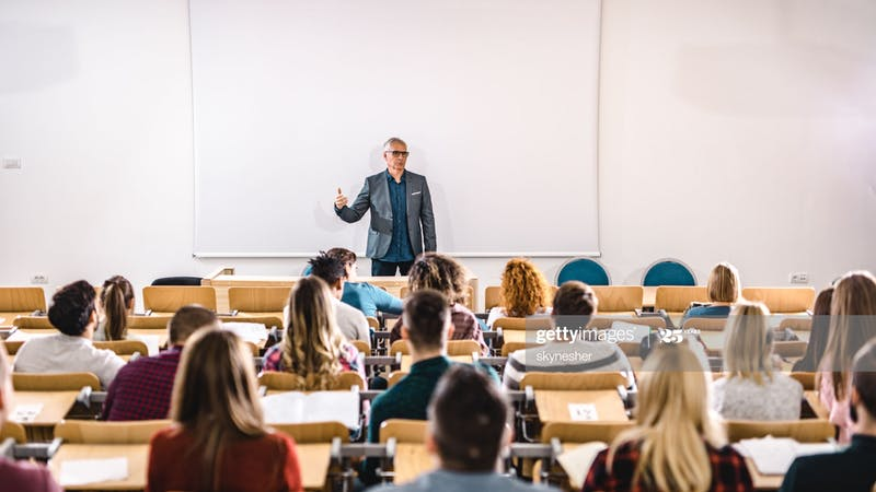 Schools, a teacher in a classroom with students
