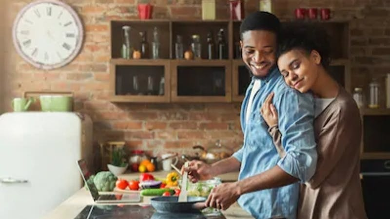 A man cooking for his wife. Women love their men cooking
