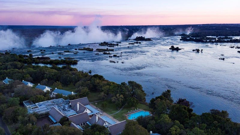 View of mist from River Zambezi Victoria Falls many kilometres away