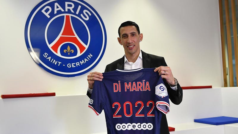 Ángel Di María poses with a PSG jersey after extending his contract till 2022.