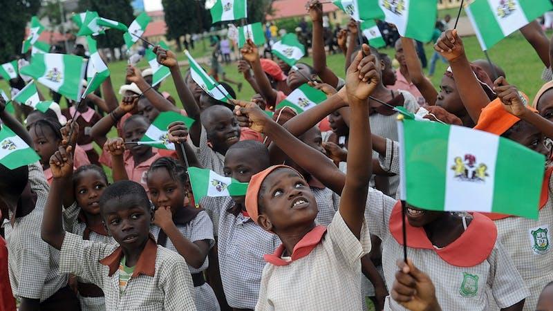 School children holding Nigeria flag