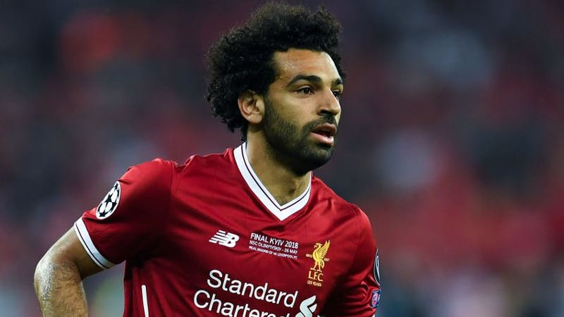 Liverpool Fc striker Mohamed Salah wearing the club home jersey