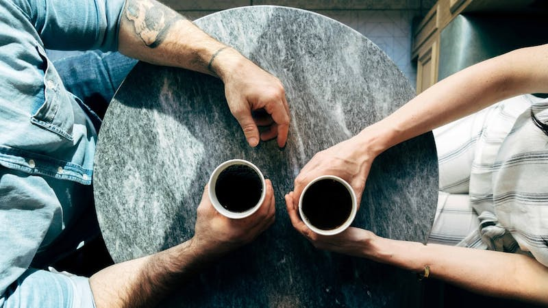 A man meets his ex-girlfriend at a coffee shop to talk things out over a cup of coffee
