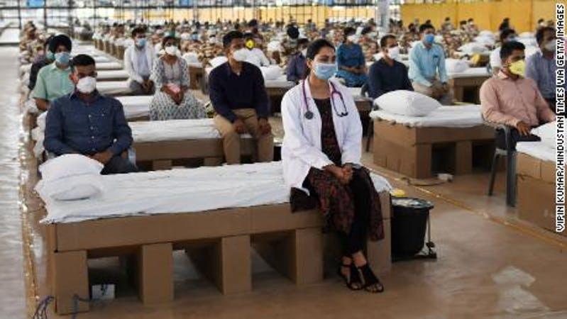Medical practitioners during the inauguration of the Sardar Patel COVID Care Centre, India's biggest hospital for the fight against COVID-19