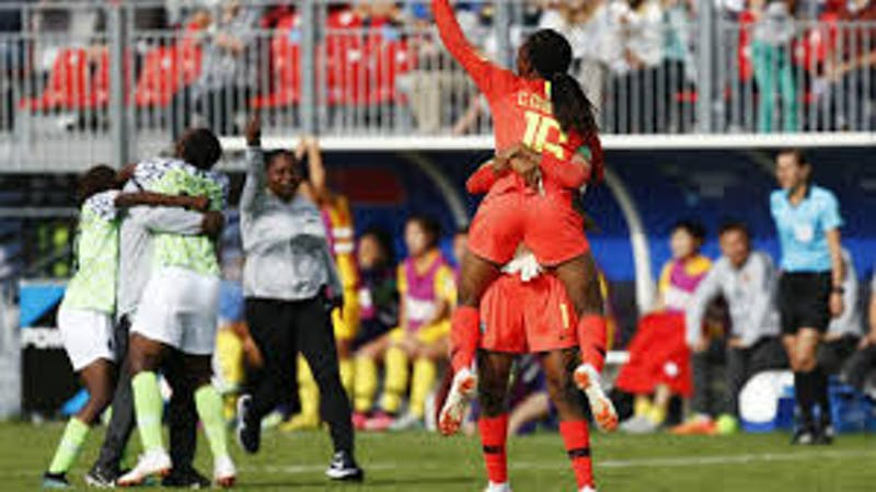 Female footballers rejoice in the pitch