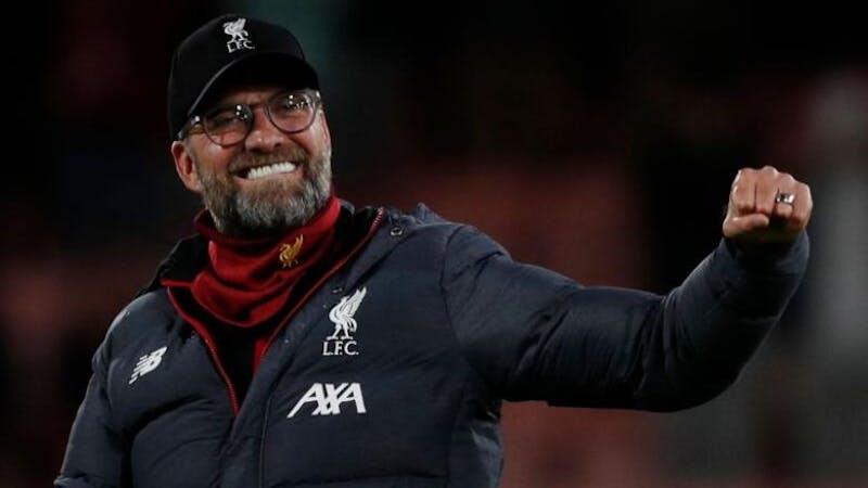 Liverpool manager Jurgen Klopp celebrating on the pitch