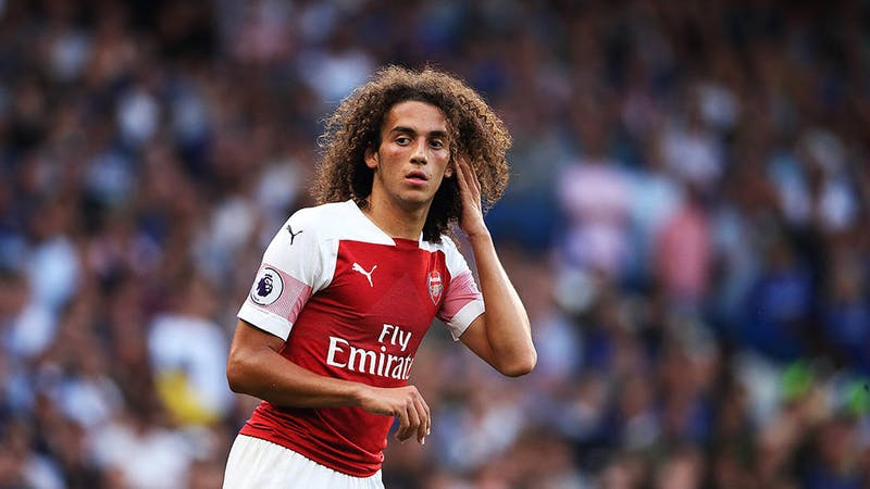 Arsenal Midfielder Guendouzi in action in the club home kit
