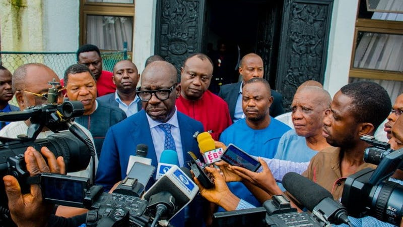 Governor Godwin Obaseki in a tussle with Oshiomole