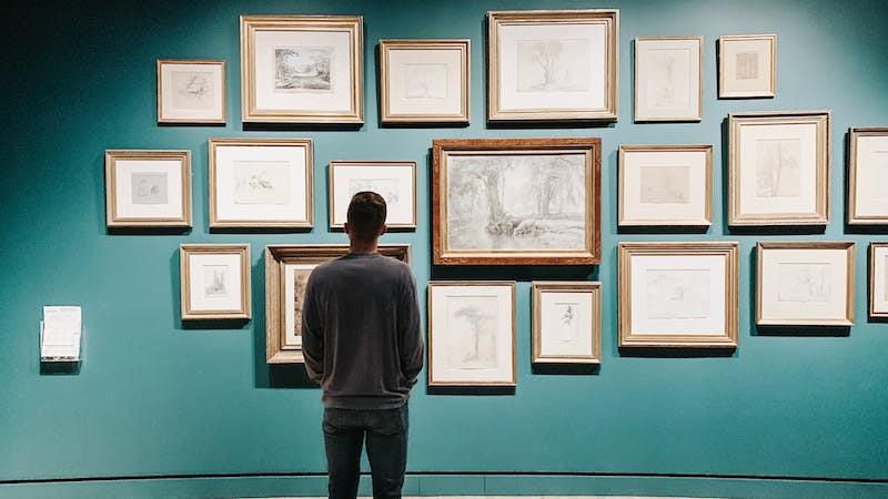 An individual watching art collections.