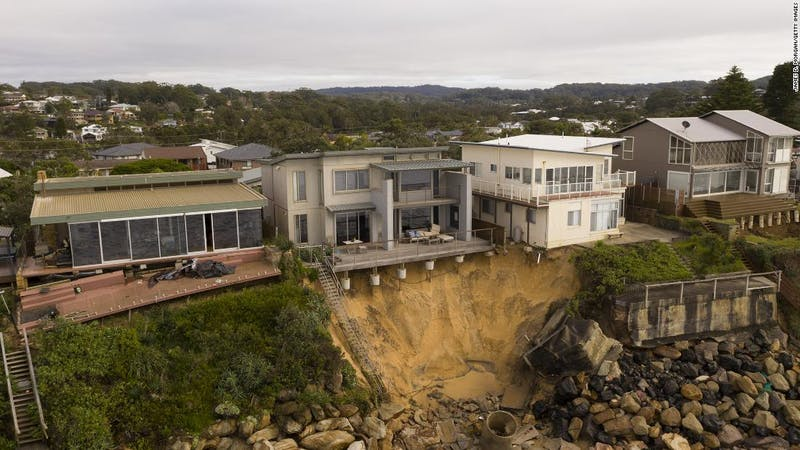Luxury beachfront homes in danger of collapsing into the ocean along the Wamberal beach in Australia's South Wales state