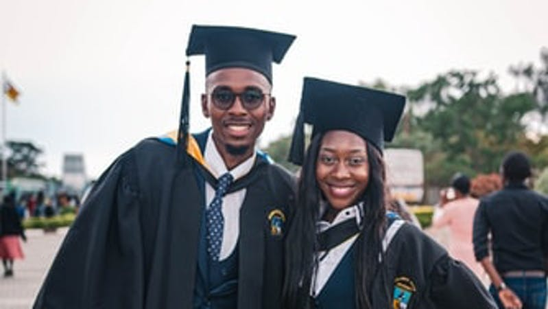 Image of two Black students on graduation day.